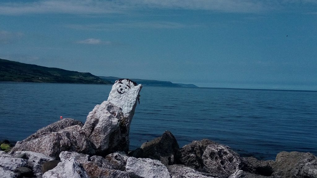 A decorated rock at the sea