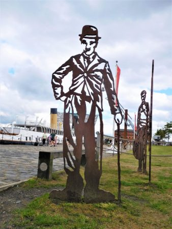 Chaplin in front of the SS Nomadic and Titanic Centre