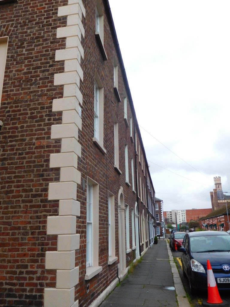 Side view with quoins (cream block work)