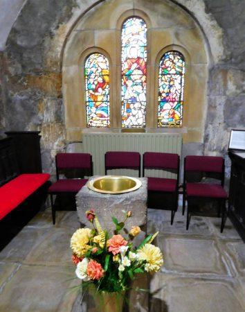 Old stone baptism font